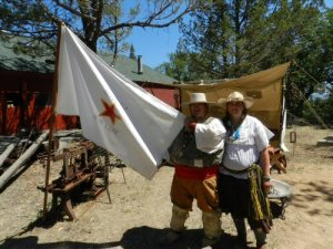 Mike and Jeanette Rodriquez display the Republica Alta Libre Flag