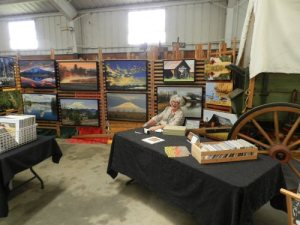 Susan Hanson of Fall River displays her photos of the Intermountain Area