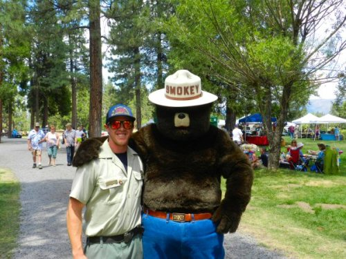 Tyler from the Forest Sevice with Smokey the Bear