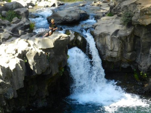 Boy fishing by Fowler Falls
