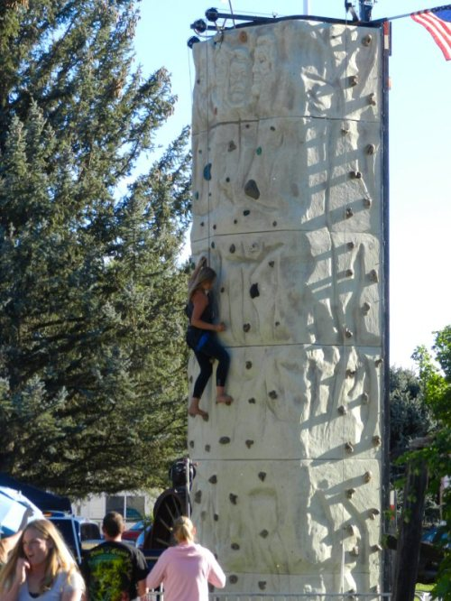Woman climbing rock wall