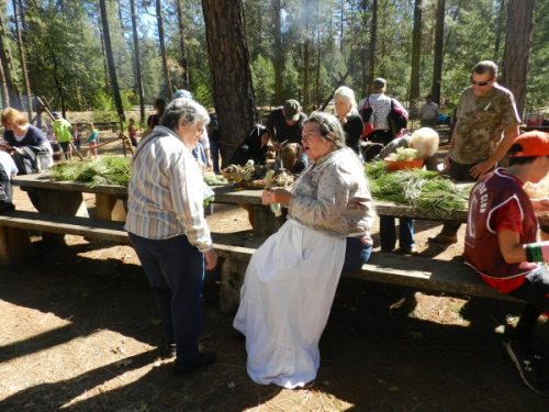 Mary Elizondo demonstrates pine doll-making