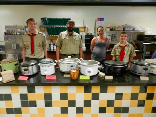 James Chapman, Scoutmaster George Chapman, Melissa Sweet, and Matt Goldman selling soup for Troop 38