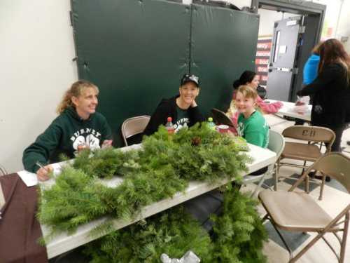 Ciera McClung and helpers selling wreaths for the Burney 4H
