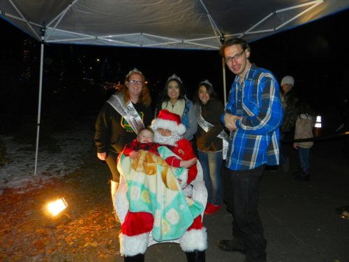 Baby Zachariah Nash and his daddy Chris with Santa and Royalty