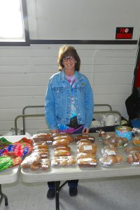 "Anita ""Cricket"" Allen with baked goods, candles and homemade jellies"