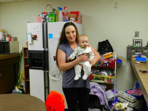 Pre-school volunteer Melissa Sweet with one of her children
