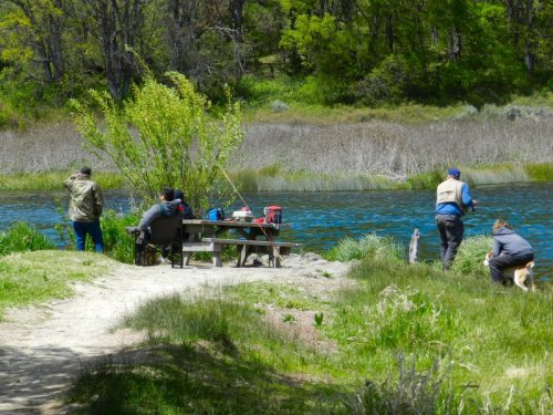Relaxing and fishing from the picnic table