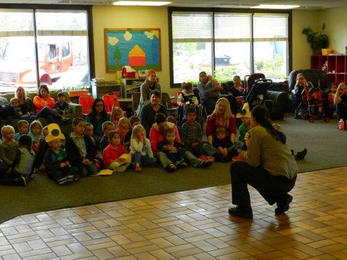 Service Officer Pruitt speaks with preschoolers