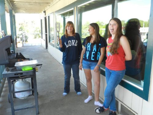 Felicity, Elizabeth and Clarissa out by the grill