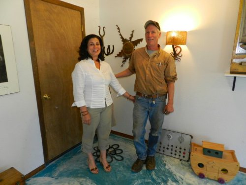 Jeff and Christina in front of some of Jeff's metalwork
