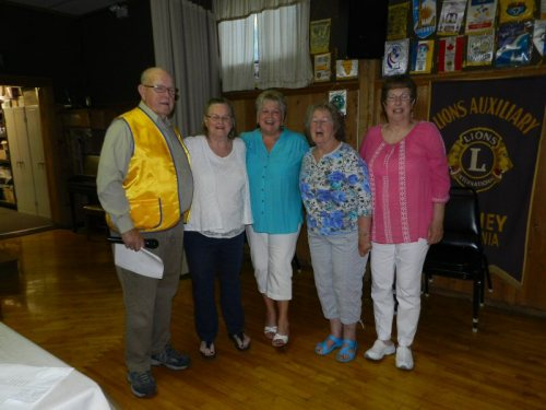 Past District Governor Stan Story installs new Lioness Officers