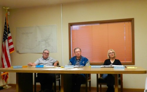 Water Board Members Fred Ryness, Roger Barkley, and Britta Rogers listen to statements by customers
