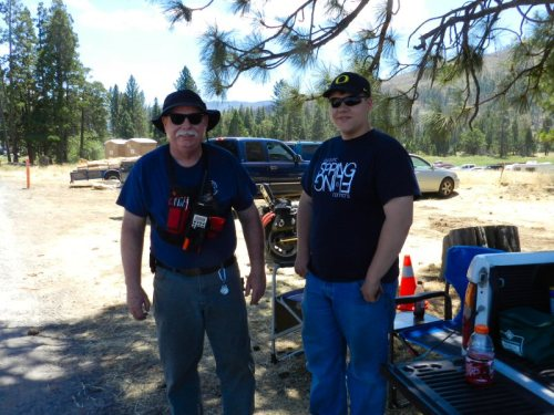 Hat Creek Volunteer Steve and his grandson Coby directing traffic
