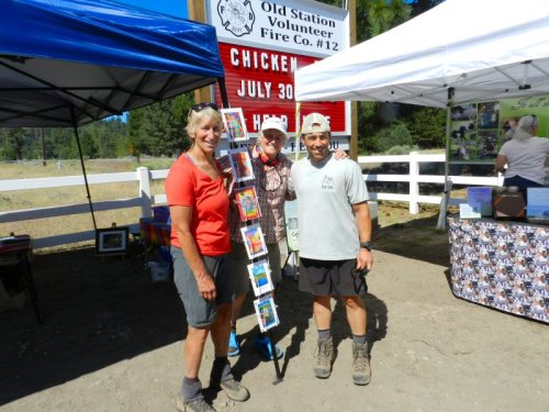 Three PCT section hikers from Sacramento browsing the craft fair