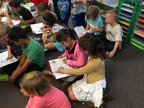 Fall River students examining their new books