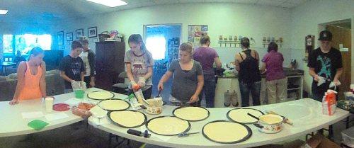 Teens making Pizza
