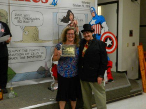 Kathie Urlie accepting Best Organization Award for Burney Boosters