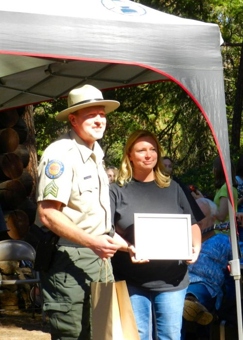 Supervising Ranger Brett Mizeur presents Melissa Madden with a certificate of appreciaton
