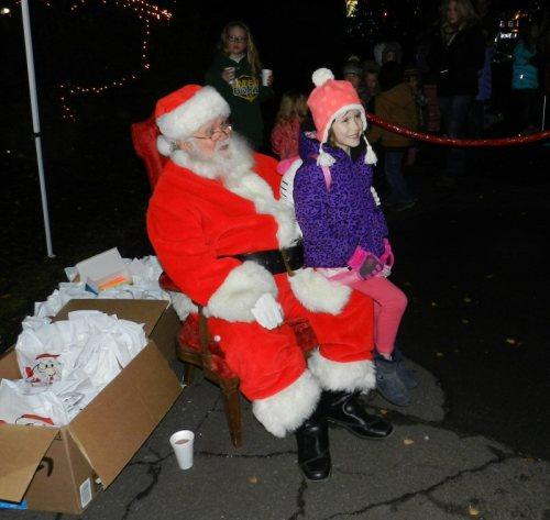 a-merry-young-girl-meets-santa