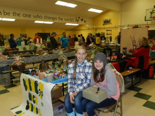Francie Ferguson and Morgan Herdon selling plants for the BHS AG Program