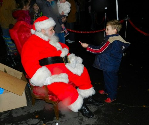 Jakob presents Santa with a little Santa that he made