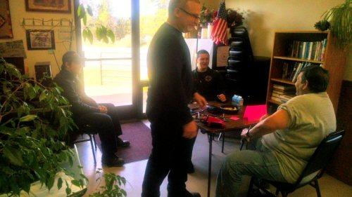 Volunteer Firemen checking blood pressure at the Senior Nutrition Center