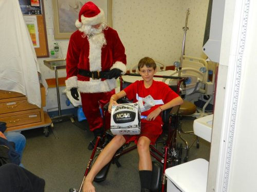 A young man at Fall River Hospital receives a visit from Santa