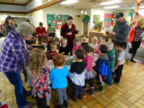 Children icing cookies