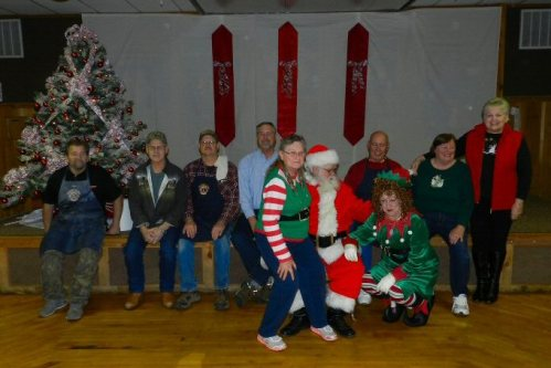 Lions and Lionesses Ron Edwards, Jim Lane, Richard Arndt, Kurt Tayor, Barbara Lane, Walt and Lorraine Libal, Michelle Mancuso,nd Ann Wilburn, together wth Santa