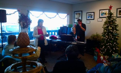 Lynn Erickson welcomes everyone to the Christmas Party