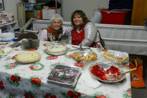 Mom and daughter serving pie and coffee