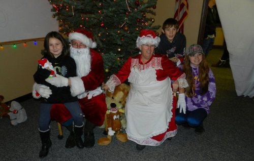 Mr. and Mrs Santa with their grandchildren Elizabeth, Casey, and Hannah