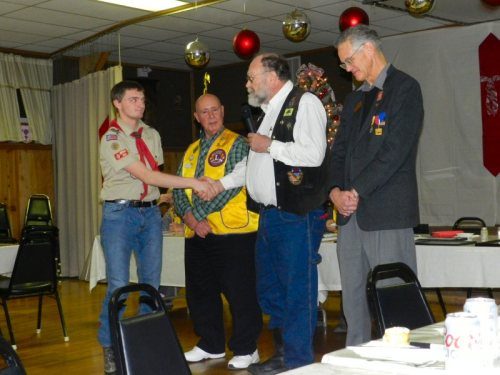 Raymond Pitham thanks Scout Chapman as Lions Walt Libal and Mike Ferrier Look on