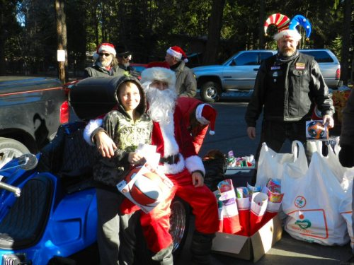 Santa and helpers with a lad at Burney Villa