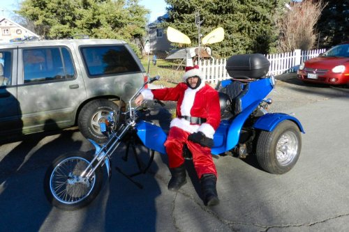 Santa and his tri-wheeler motor sled